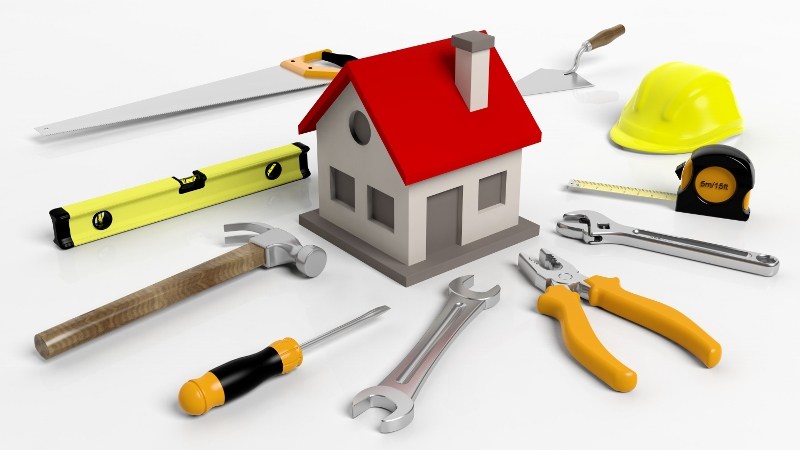 House model with tools isolated on white background