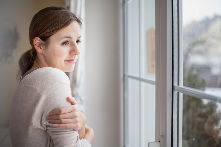 freezing-woman-looking-from-a-window